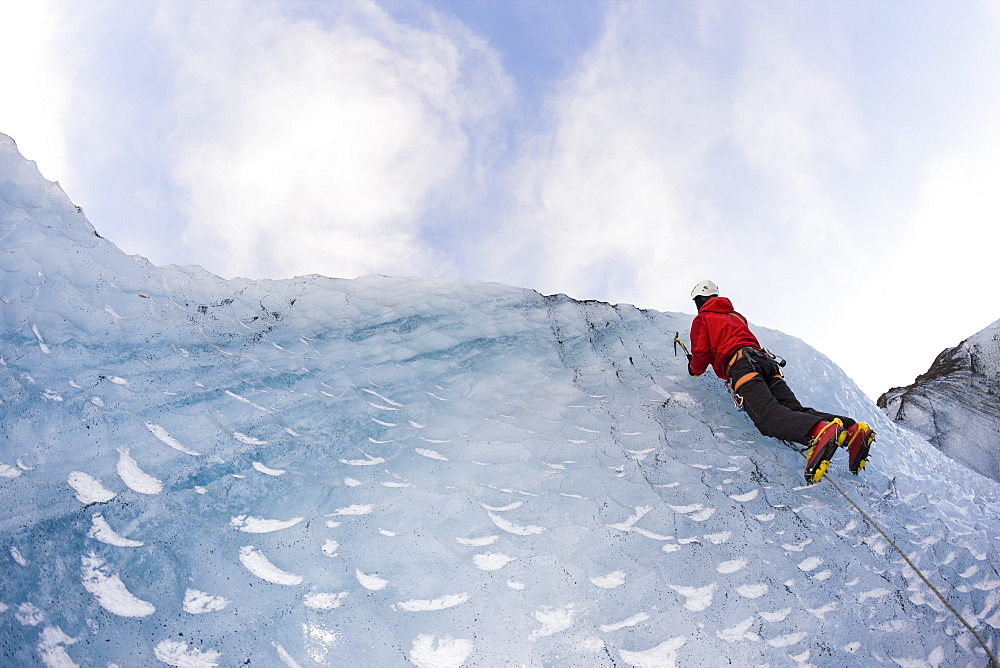 Climber on the icelandic glacier Solheimajokull during winter. South Iceland. - 857-90047