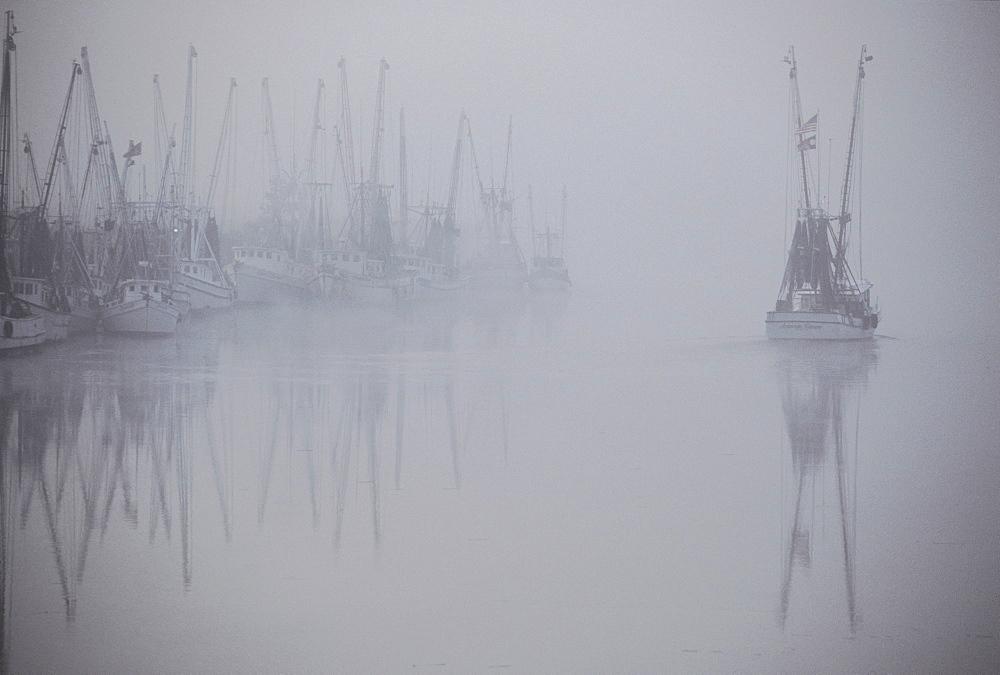 A hazy view of shrimp boats in Darien, Georgia, USA,