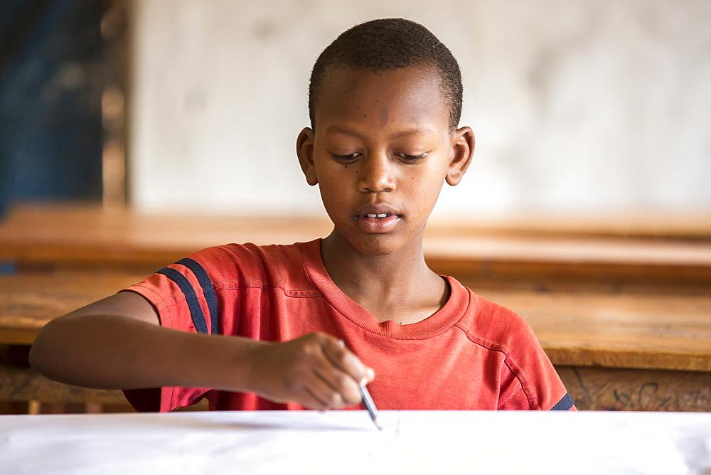A student works on a project at the Kiziba Refugee Camp in Kibuye, Rwanda.