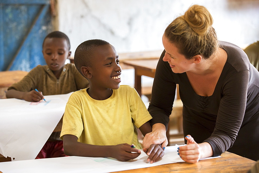 A visiting teacher interacts with a student at the Kiziba Refugee Camp in Kibuye, Rwanda.