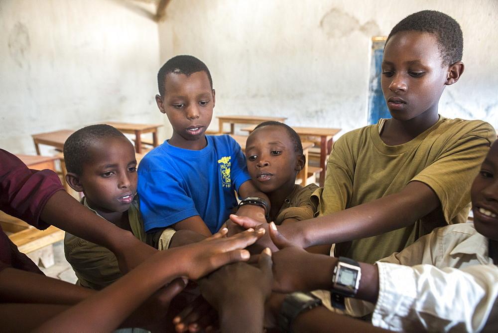 Student work on a problem solving game at the Kiziba Refugee Camp in Kibuye, Rwanda.