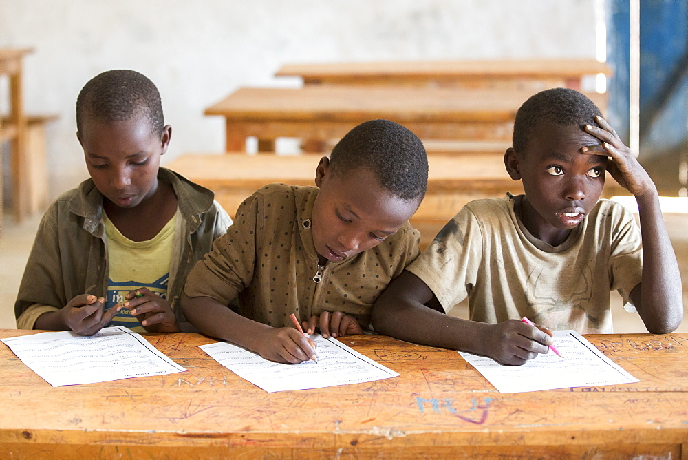 Students work on an assignment at the Kiziba Refugee Camp in Kibuye, Rwanda.