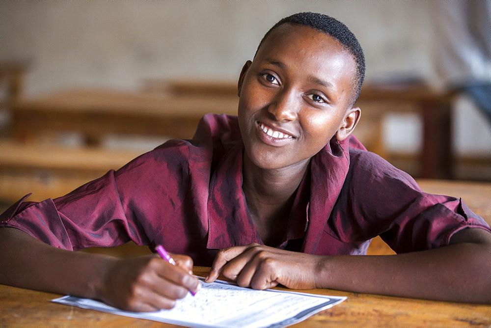 A female student is photographed at the Kiziba Refugee Camp in Kibuye, Rwanda.