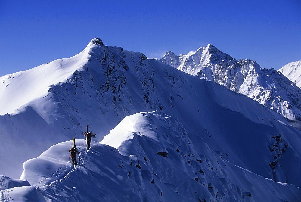 Chris Davenport and Matt Ross hiking ridgeline at Aspen Highlands, CO, United States of America