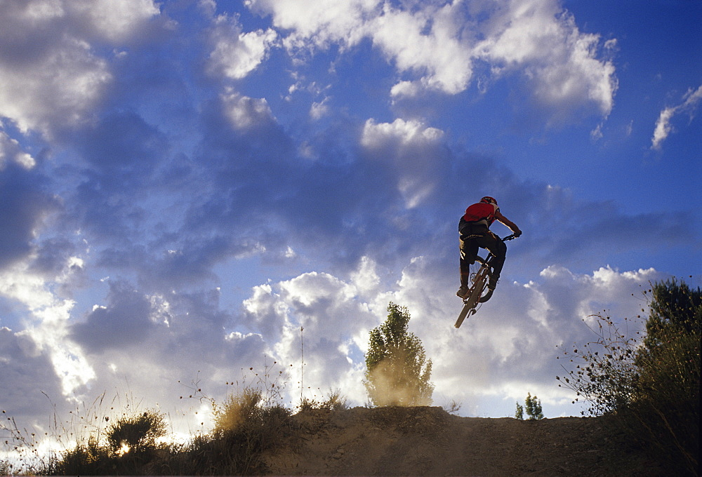 Bruno Penone jumping his mountain bike at sunset in Roussillon, France, France