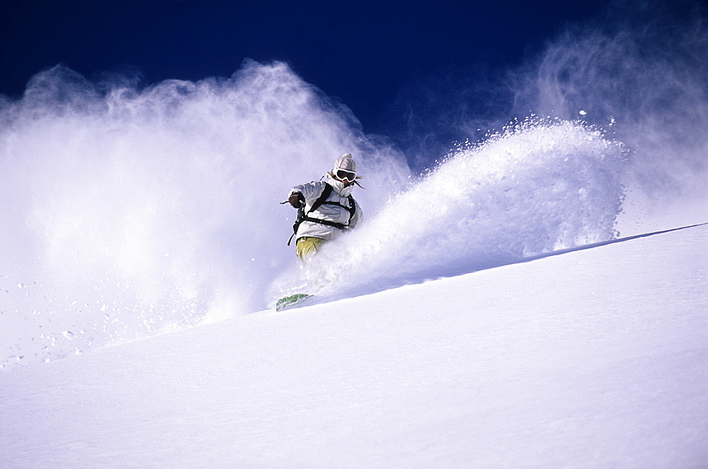 Megan Pischke boarding deep powder in the Wasatch Mountains, Utah, United States of America