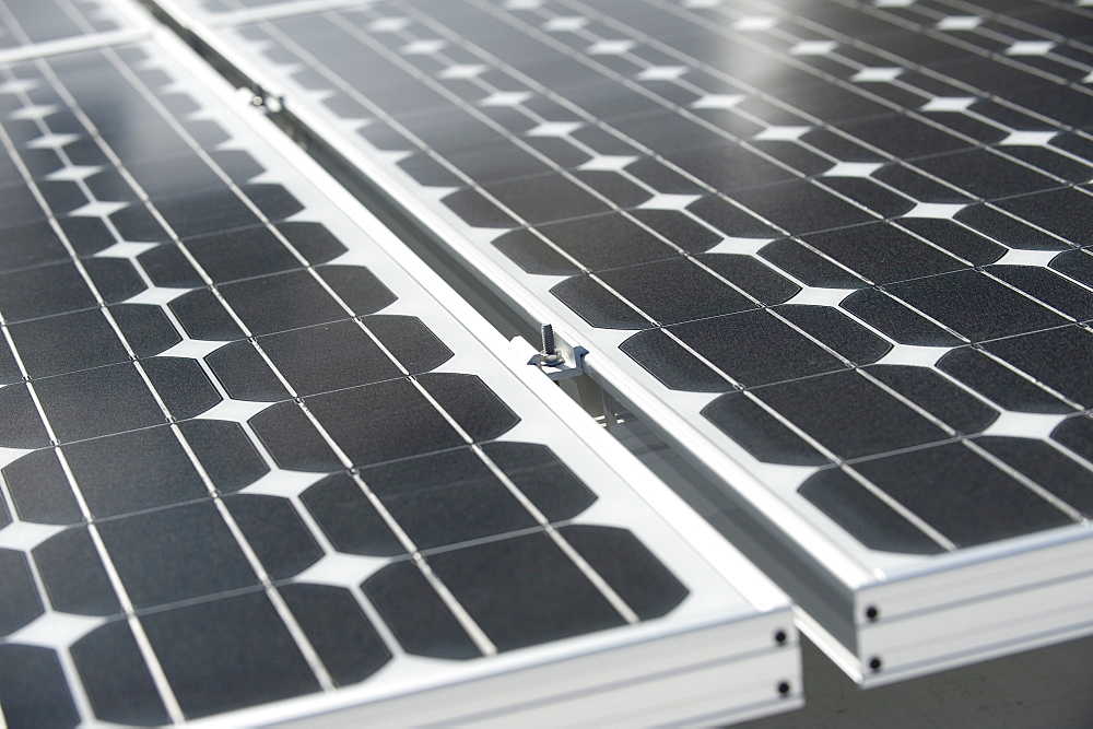 Closeup of a photovoltaic panel with the sun reflecting, United States of America