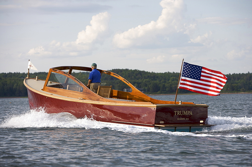 Senior man drives a power yacht in Somes Sound, Maine, United States of America - 857-90748