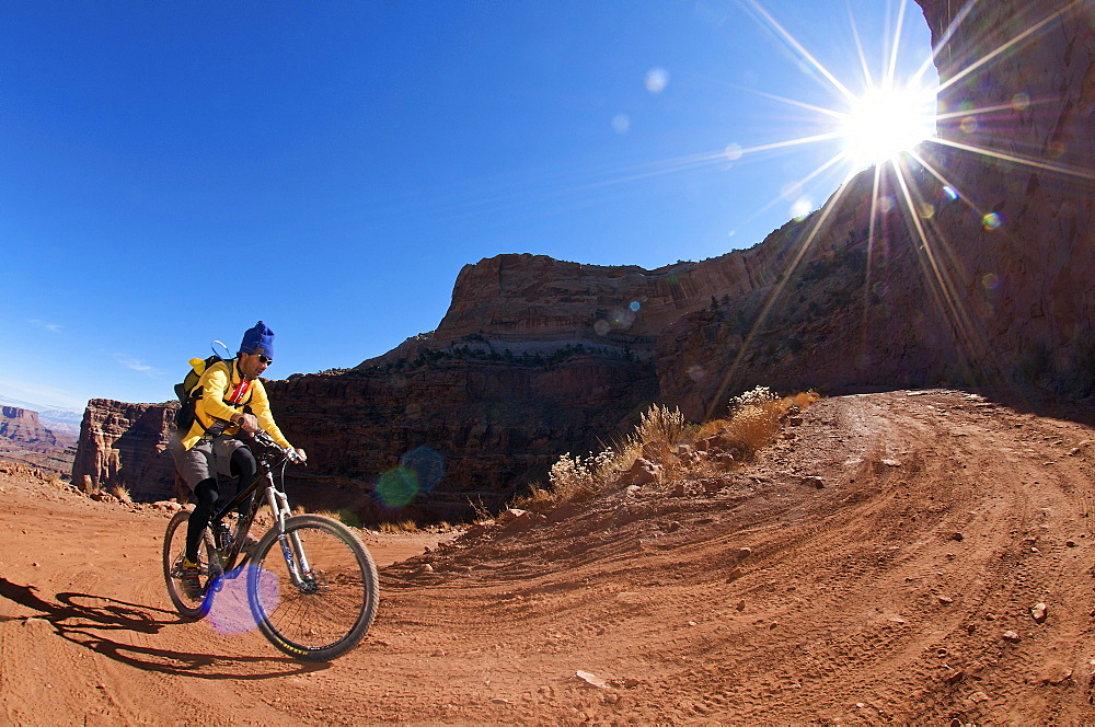 Jeet Grewahl riding the long climb out of Shafer Canyon on the White Rim Trail in Canyonlands National Park, UT, United States of America