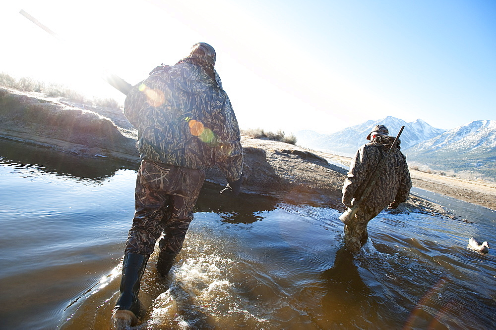 Brad Jackson and Corey Funk hunt ducks with their dog Grizzly in Carson City, NV, United States of America