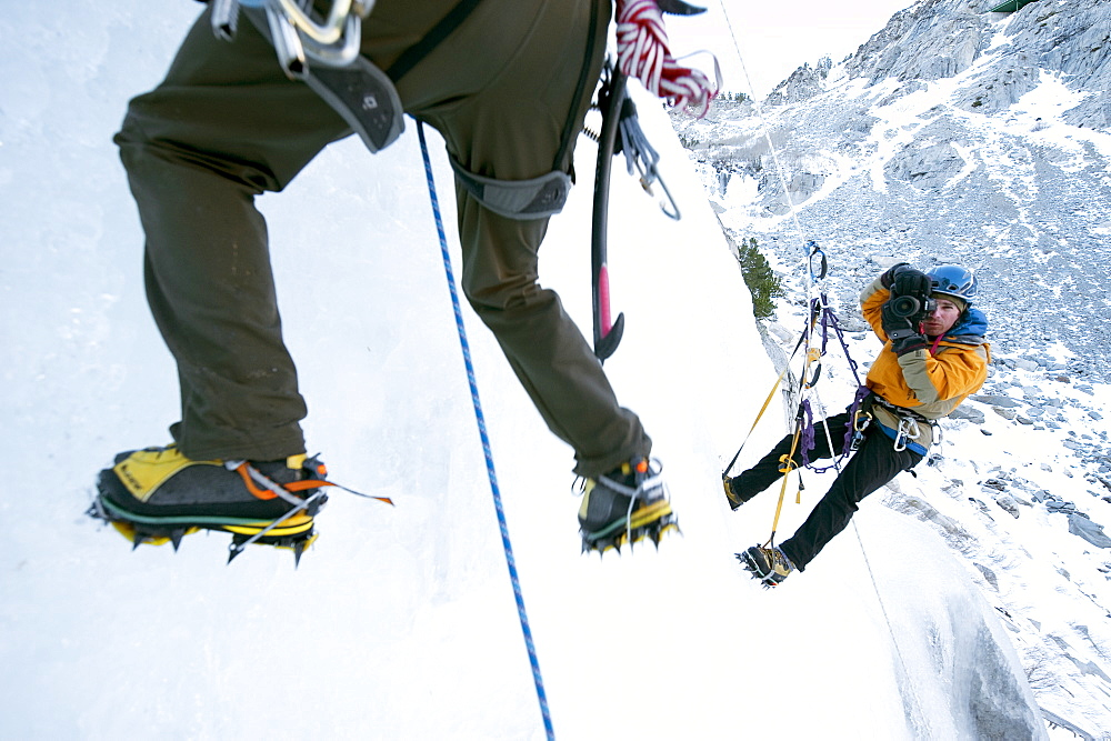 Corey Rich photographs Zach Fletcher while ice climbing in Lee Vining, CA, United States of America