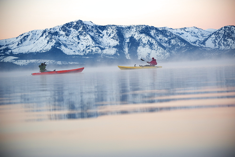 Corey Rich photographs Spencer Ray during an early morning paddle on Lake Tahoe, Stateline, NV, United States of America - 857-90942
