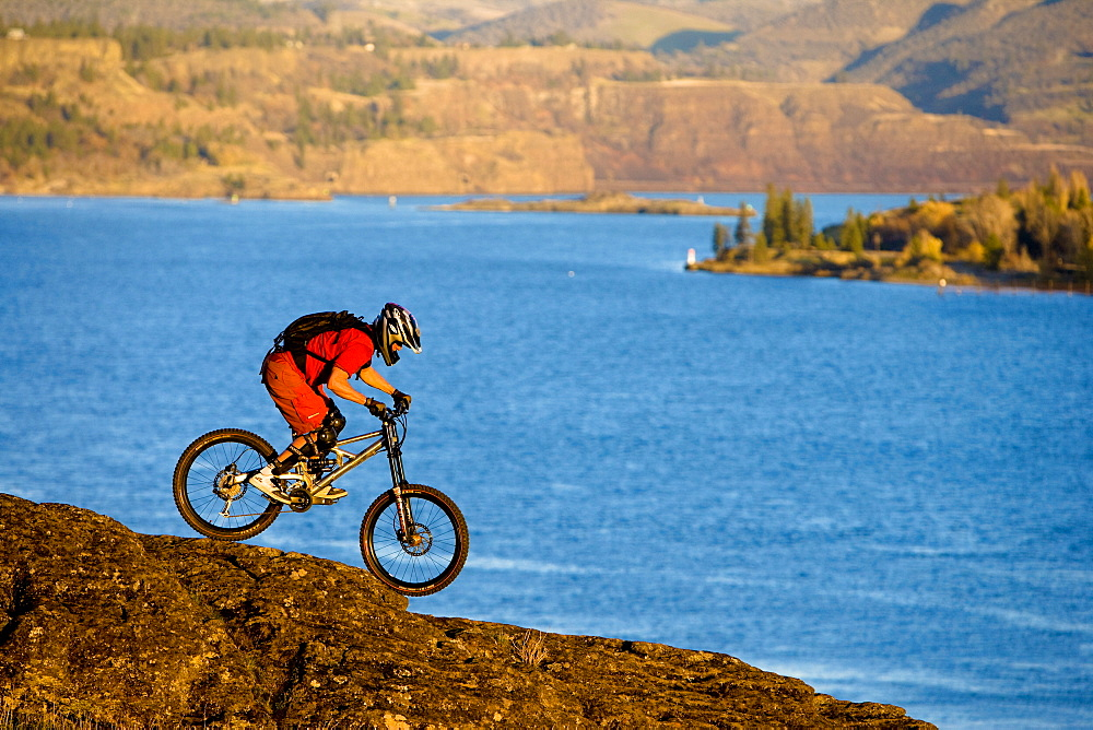 Dan Gavere does his best balancing act on the basalt rock east of Hood River, Oregon, United States of America
