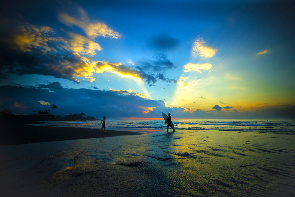 Surfers at sunrise. Bali. Indonesia. - 857-91312