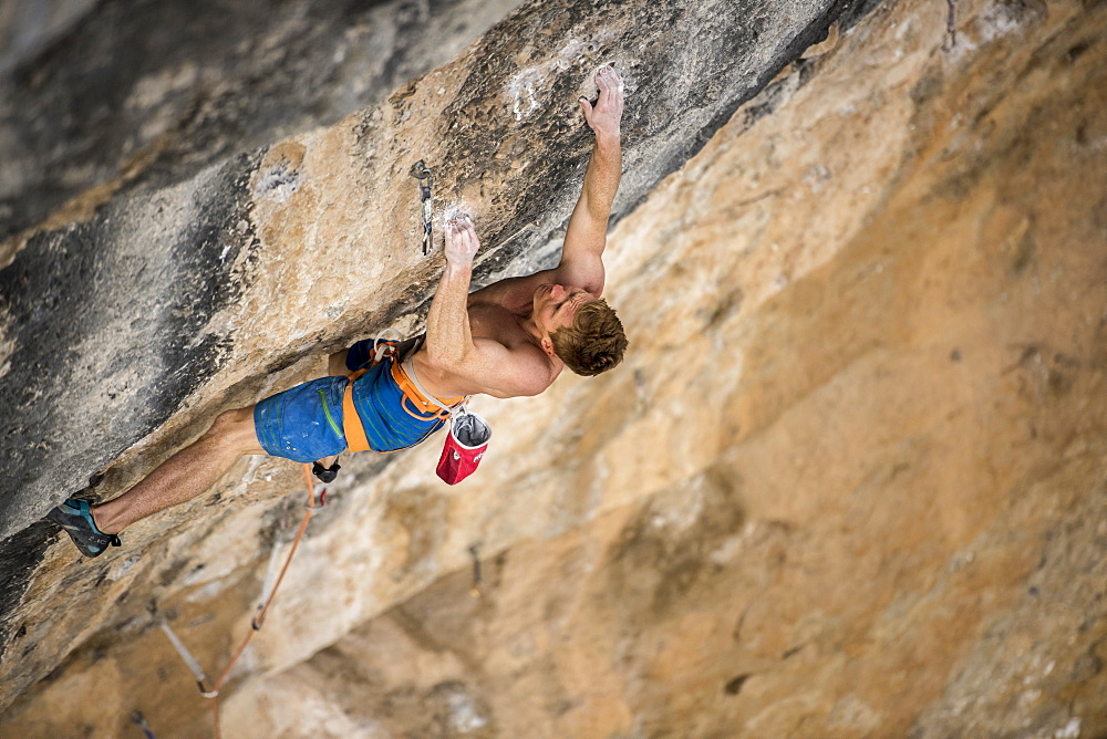 Nowegian climber Magnus Midtbø climbing Papichulo 9a+ in Oliana, Spain.