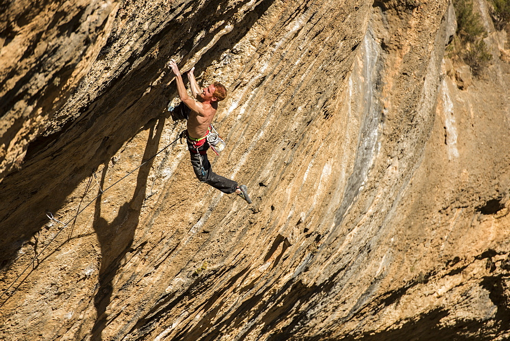 Professional italian climber Gabriele Moroni climbing an 8c route in Margalef, Spain.