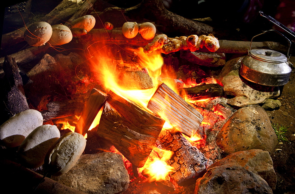 bread rolls on a campfire