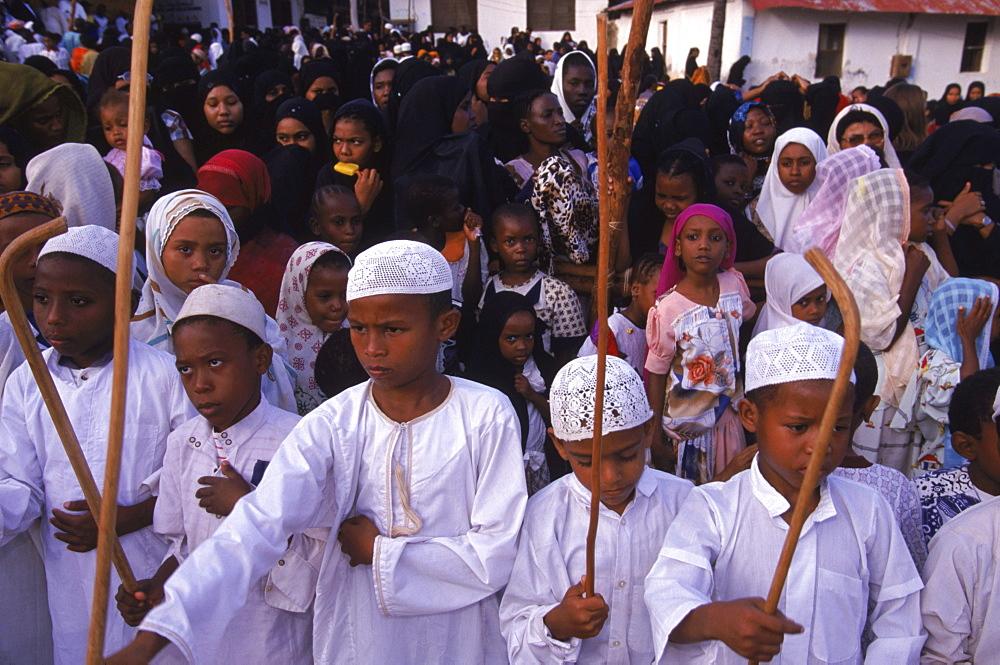 Swahili boys performing the stick dance at a celebration of Maulidi, the birthday of the porphet Mohammed. Lamu Island, Kenya