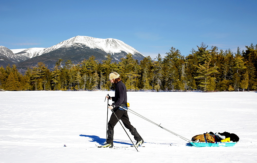 Man cross country skiing in Baxter State Park