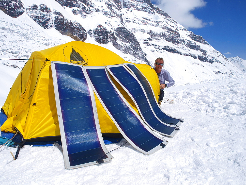 Manaslu mountaineering expedition 2008, Nepal Himalayas: Mountaineers are using solar panels to charge elcetronic equipment.