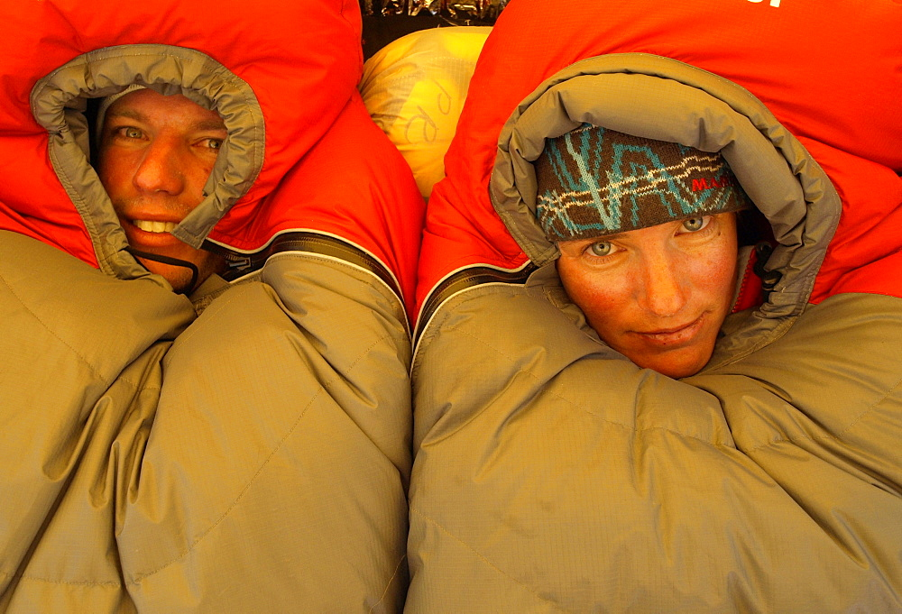 Manaslu mountaineering expedition 2008, Nepal Himalayas: Two mountaineers in their sleeping bags in camp one at 6100 meter altit