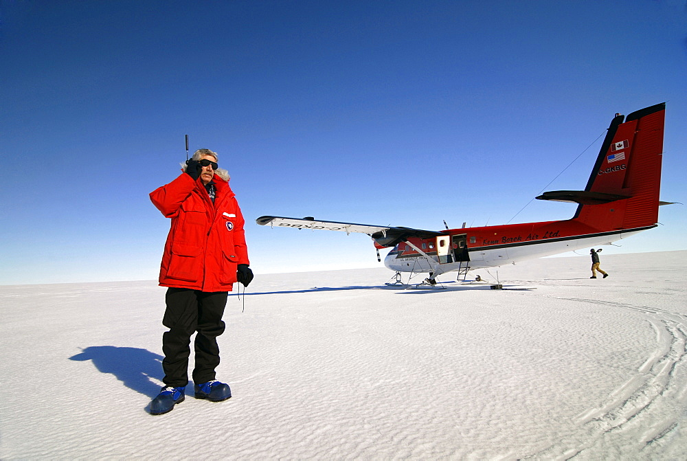 A man calls home after safely landing in the Western Antarctic. - 857-91954