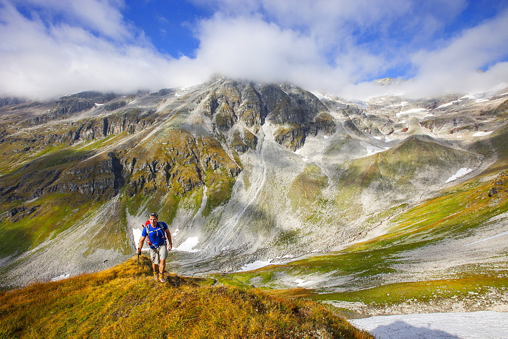 A male hiker during the Glocknerrunde, a 7 stage trekking from Kaprun to Kals around the Grossglockner, the highest mountain of Austria.