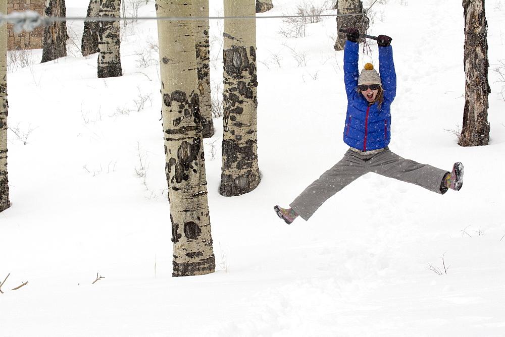 A girl riding a zipline, Telluride, Colorado.