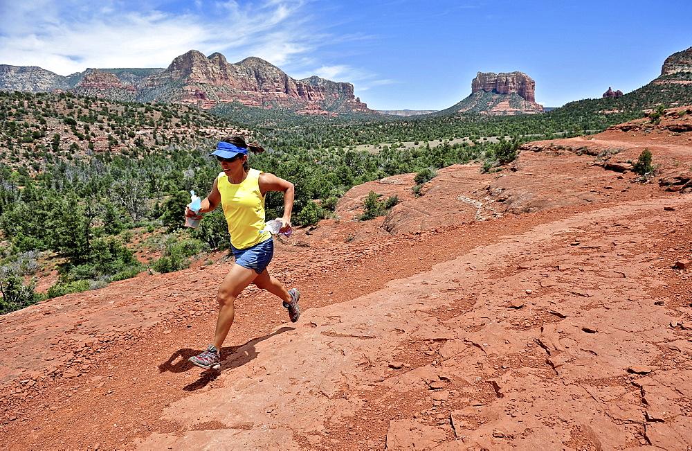 Woman runs the Cathedral Rock Trail in Sedona, Arizona May 2011.