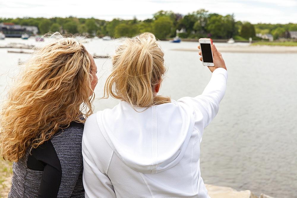 Two friends taking selfies