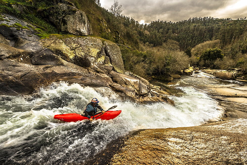Spanish whitewater kayaking is paddling down a slide of the Rio Umia.