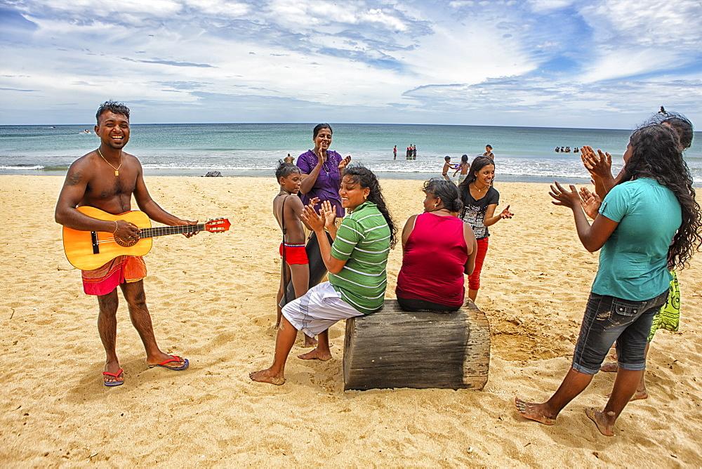 Sri Lankans singing in Nilaveli Beach. Trincomalee. Sri Lanka