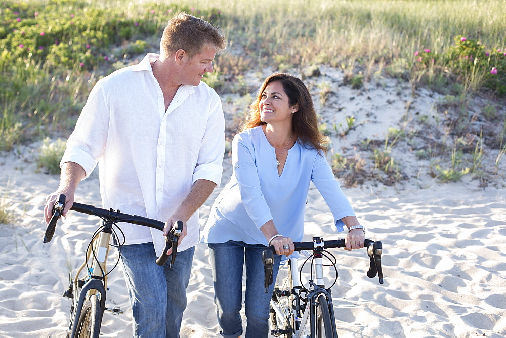 A couple are photographed at a Cape Cod beach, United States of America.