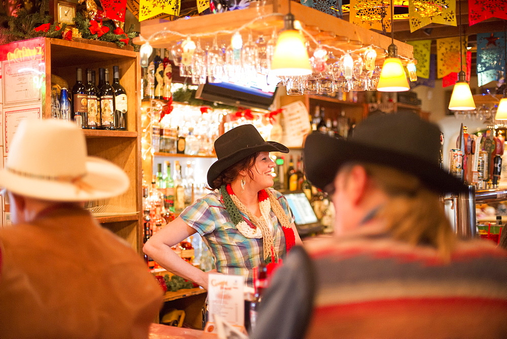 A bartender chats with patrons at the Cowgirl BBQ restaurant in Santa Fe, New Mexico, on Dec. 21, 2013.