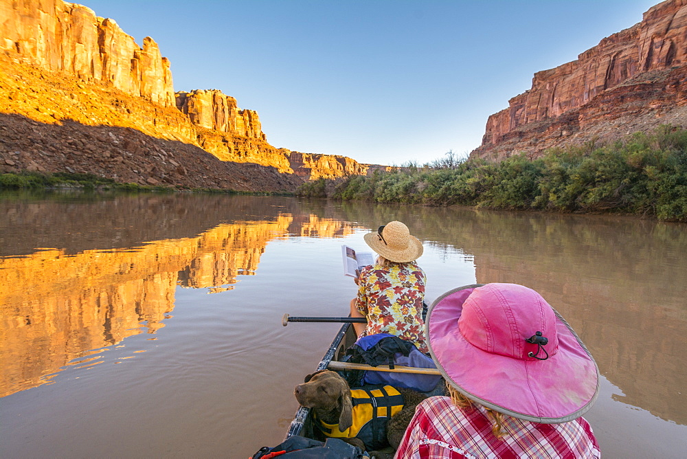 A mother and daughter canoeing along the  Labyrinth Canyon section of the Green RIver, Green River, Utah.