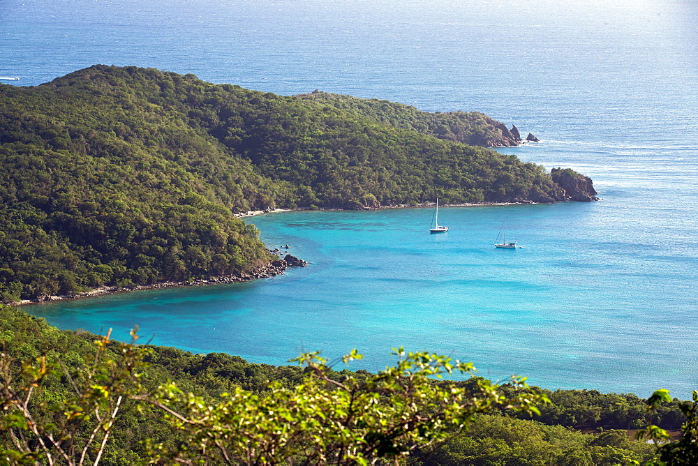 A stunning view overlooking sailing yachts anchored in Great Lameshur Bay, from Bordeaux Mountain trail, St. John, US Virigin Islands.