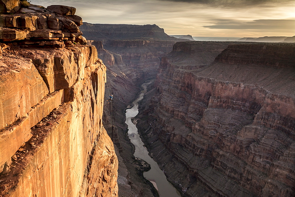 A woman rappelling off Toroweap Overlook above the Colorado River, Grand Canyon National Park, Fredonia, Arizona. - 857-93049