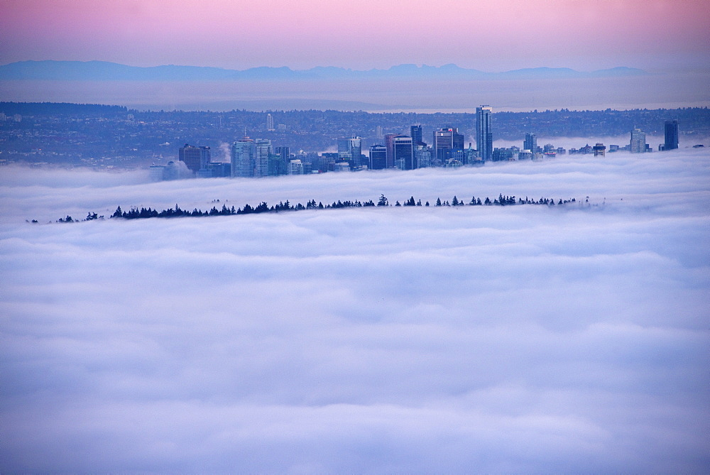Fog inversion over downtown Vancouver and Stanley Park. Vancouver, British Columbia