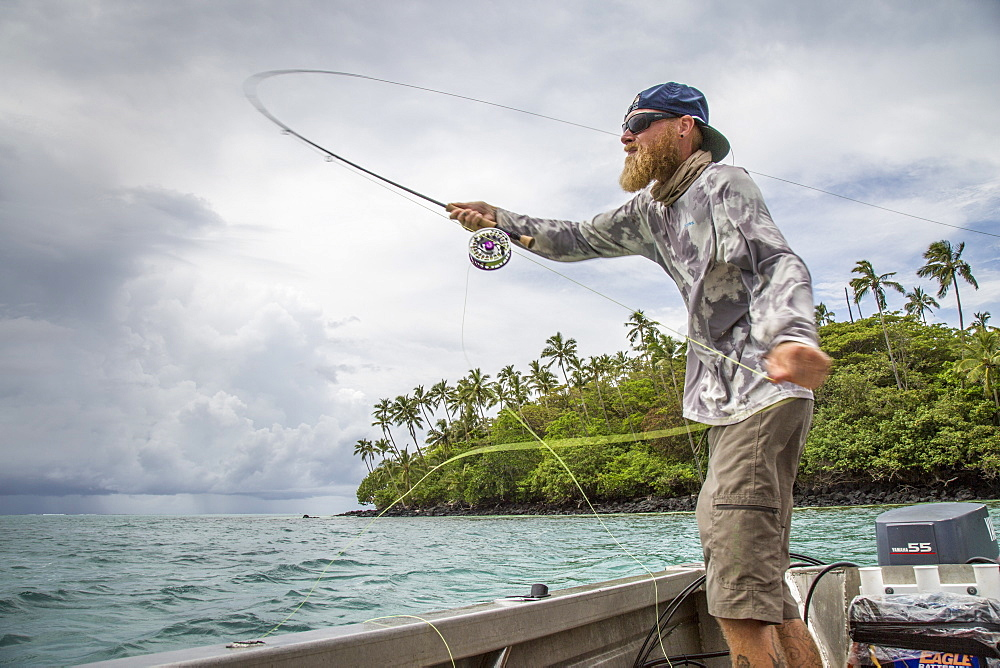Angler Jonathan Jones casts while fly fishing for Giant Trevally while on location in Samoa.