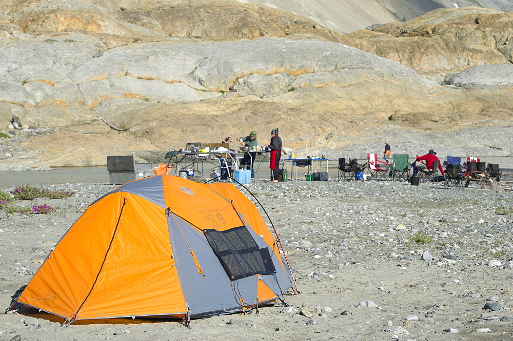 Solar panel hanging from tent along the shores of the Alsek River