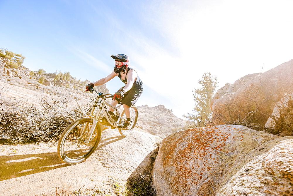 Man Mountain Biking On Rocky Landscape In Gunnison