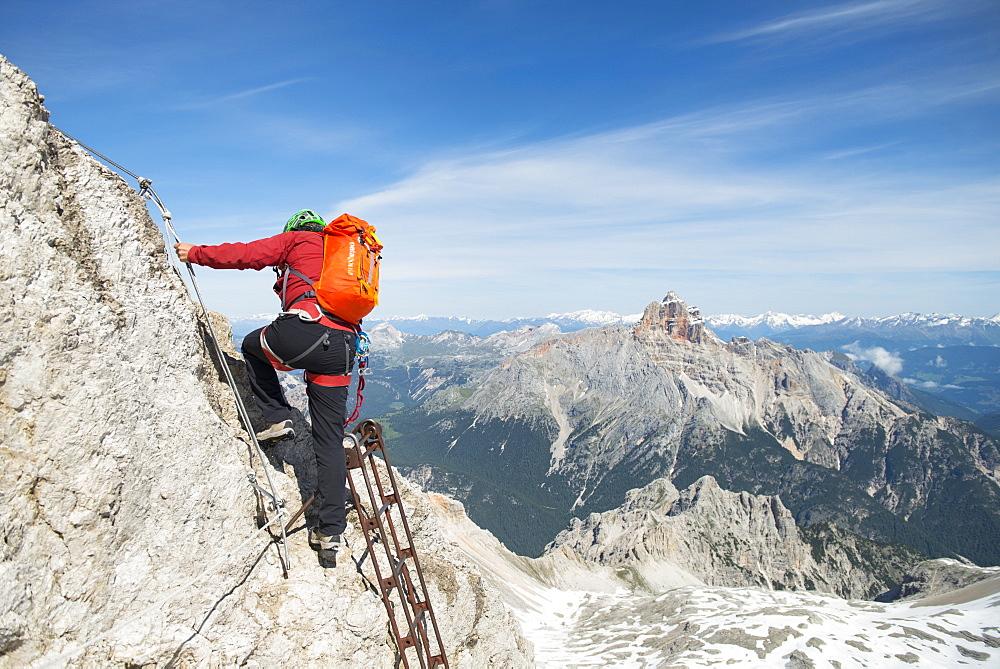 Man Climbing At Via Ferrata Ivano Dibona In The Dolomites, Italy