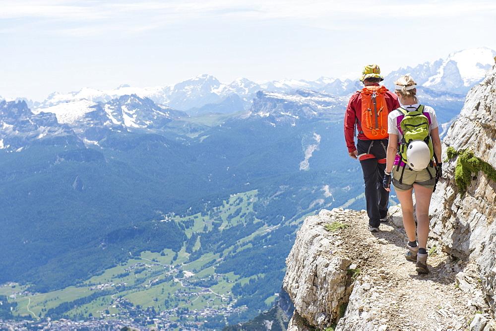 A Couple Climbing At The Via Ferrata Ivano Dibona
