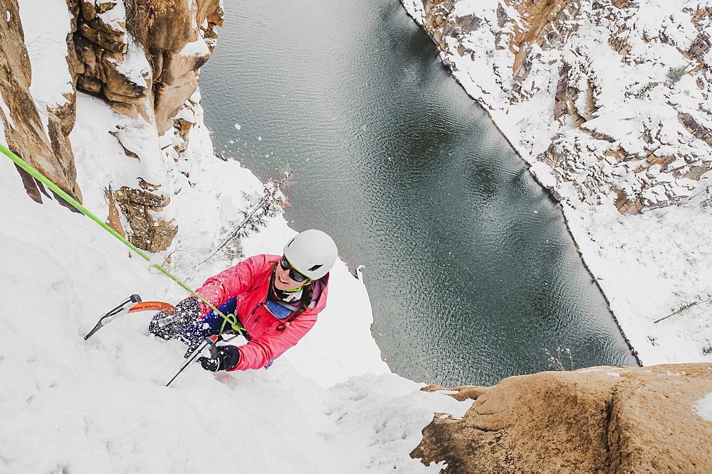 High angle view of woman ice climbing at Chipeta falls, Colorado