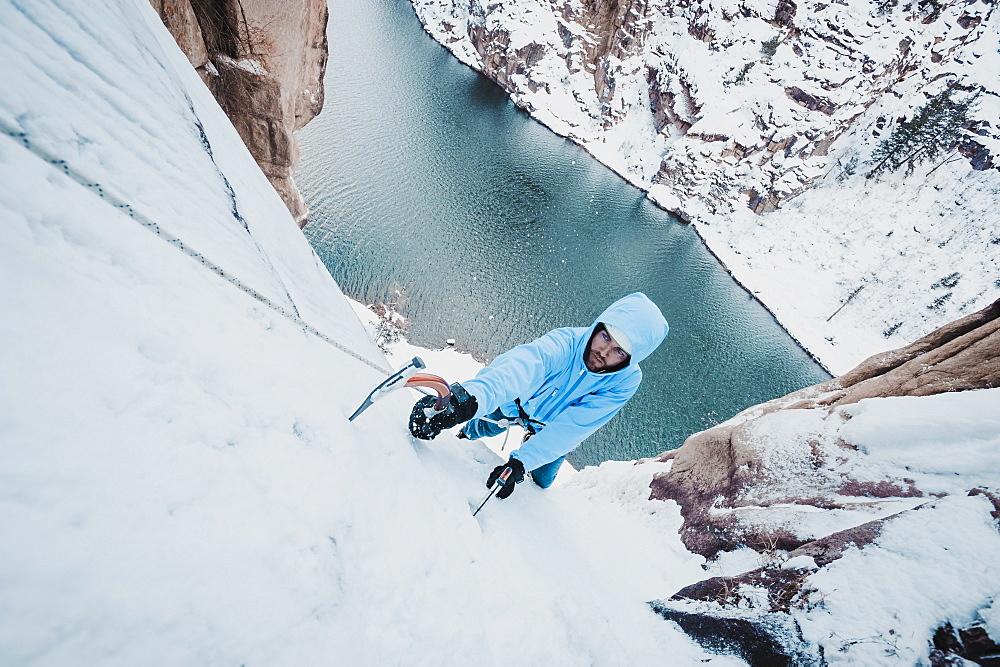 High angle view of Man ice climbing at Chipeta falls, Colorado