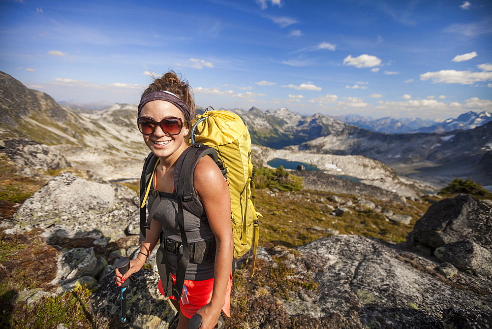 Smiling Young Woman With Backpack Hiking In Mount Marriott