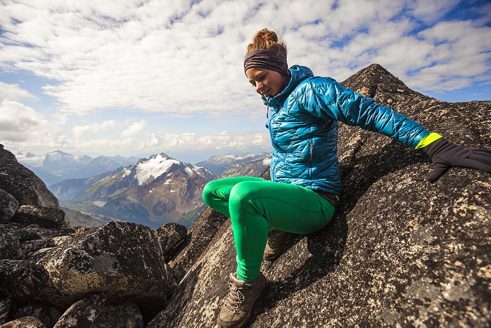 Female Climber Descends From Rocky Ridge On Mount Marriott