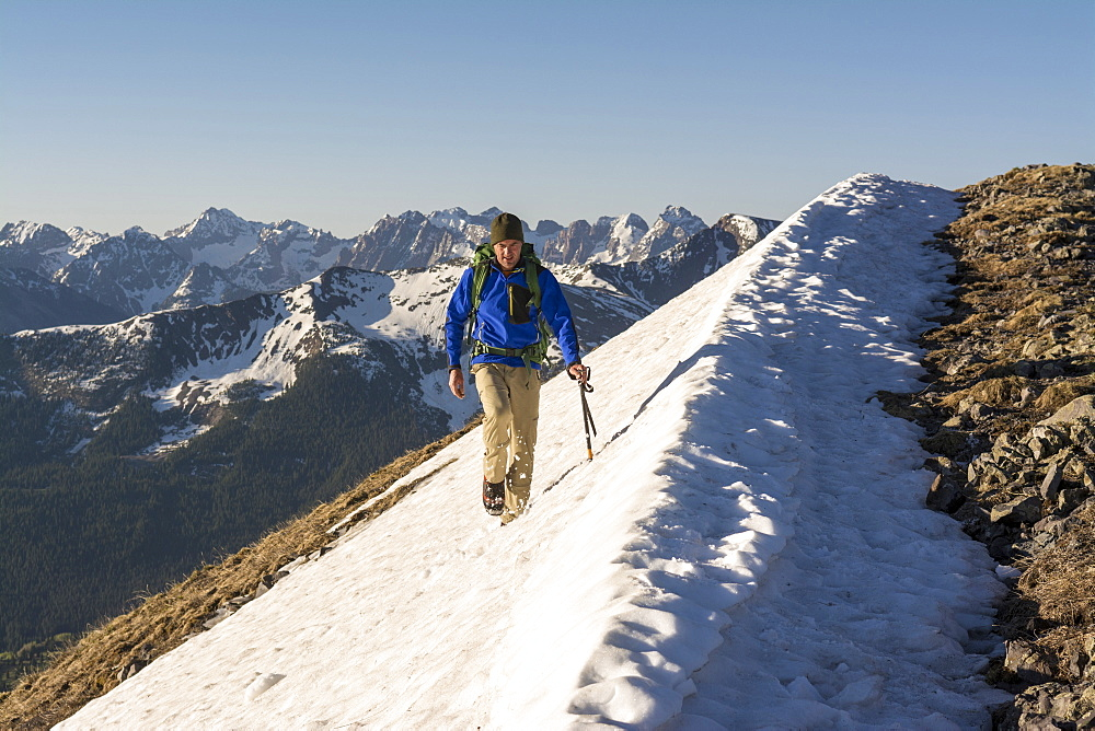 A Man Hiking A Snowslope Above Molas Pass In San Juan National Forest, Durango, Colorado