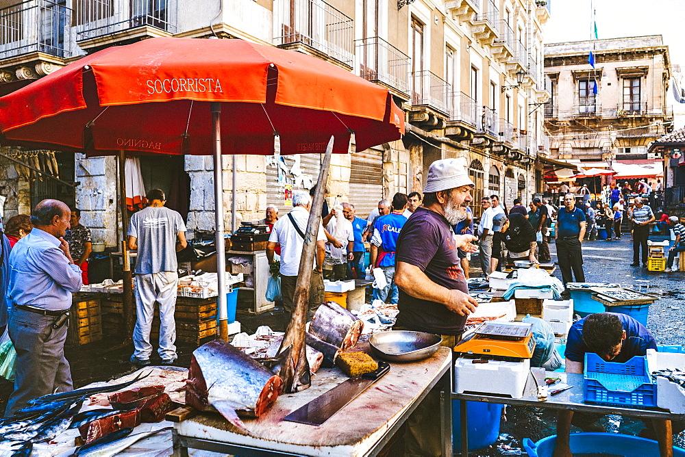 A Fish Monger At The Catania, Sicily Fish Market