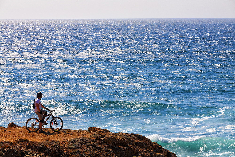 Cyclist Exploring Oceanic View In Sintra Cascais Natural Park